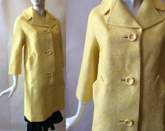 Early 1960's lemon chiffon pie yellow boucle coat, oversize round notched buttons, notched collar & 3/4 sleeves, md - lg / 10-12