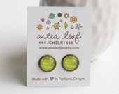 white and lime green polka dot illustrated post earrings