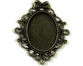 1 Antiqued Brass Cameo Setting with Bow and Rhinestone Accent Settings - 25x36