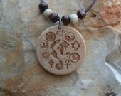 Round World Religions Engraved Wood Necklace