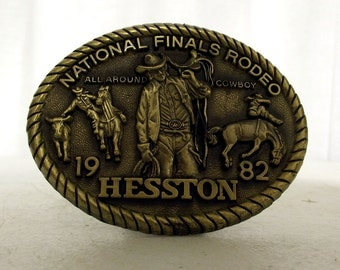 1982 Hesston National Finals Rodeo All Around Cowboy Belt Buckle NFR steer wrestler - bronc rider