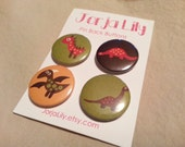 "Set of four 1"" pinback buttons Dinosaur"