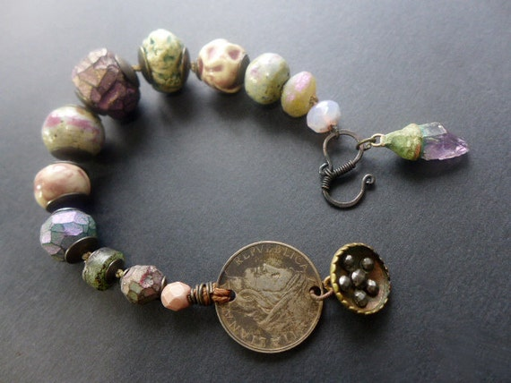 Eudaimonia. Rustic assemblage bracelet with lilac and green art beads, coin, cut steel shaft button.
