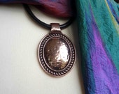 Large copper vintage pendant thick leather cord
