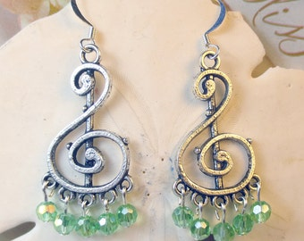 Green Chandelier with czech beads on a musical note charm, green chandeliers, august birthday earrings, green earrings holiday earrings