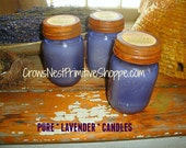 Pure Soy Lavender Candle made with natural soy wax and pure essential oil of lavender in a purple mason jar with rusty lid