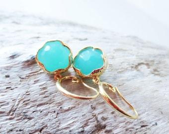 Aqua earrings. Framed glass earrings. Gold dangle earrings. Light blue earrings. Pendant earrings. Round earrings. Bright blue earrings.