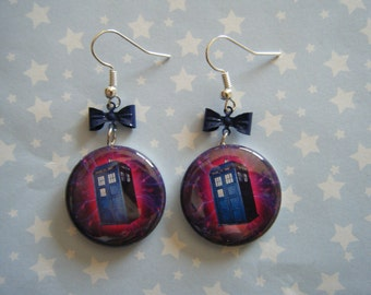 Tardis in space with blue bows dangle earrings on silver ear wires