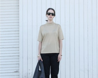 Gold knit short sleeve mock turtleneck. S