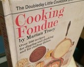 Cooking Fondue by Marian Tracy 1970 HC  99 pages, over100 receipes for dipping and dunking.  Chafing dishes and fondue pots. VG+ condition.