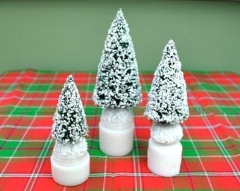 Small Christmas trees set of 3 bottle brush trees on antique white jars, tree trio