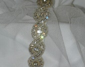 Crystal rhinestone headband with braided pattern with large center rhinestones for beautiful sparkle.