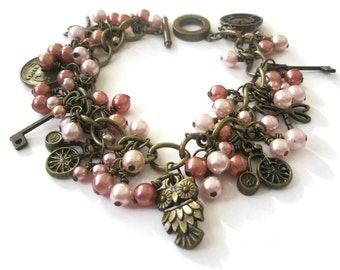 Bracelet Charm Pink Glass  pearls Antique Gold Owl Dragonfly Coins Keys penny farthing bicycle cluster jewellery Vintage style