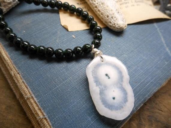 The Nova Solar Quartz Pendant Necklace. White Solar Quartz Green Goldstone Orbs and Sterling silver necklace