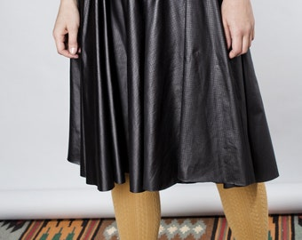 LAST SALE 50% off!!!! under 50, Black leather like glossy skirt with stretch belt