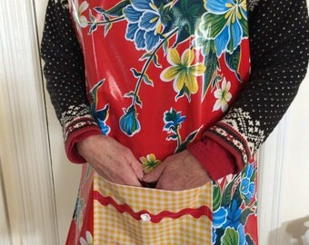 Tropical flowers on tomato red --- full sized apron in oilcloth