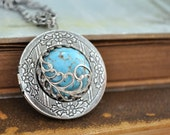 locket necklace, antiqued silver plated brass locket, ROBIN'S NEST, blue turquoise color vintage glass cab necklace, feather necklace,