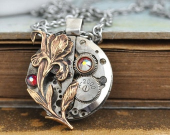 steampunk jewelry, steampunk necklace, LOVE TAKES TIME, vintage mechanical watch movement with iris flower and ab pink Swarovski rhinestone