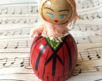Little wooden Polish doll