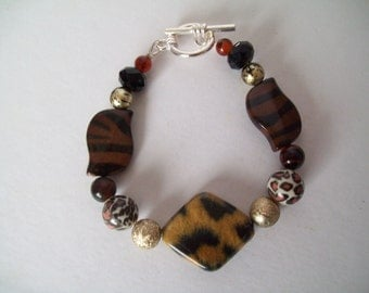 Wild side bracelet with mixed brown and animal print glass, clay and resin beads