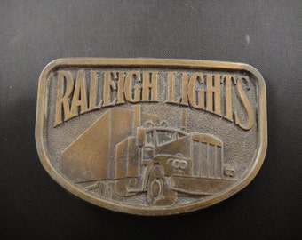 Raleigh Lights Brass Belt Buckle Advertising