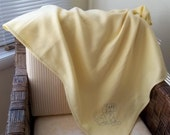 Yellow Fleece blanket with embroidered puppy