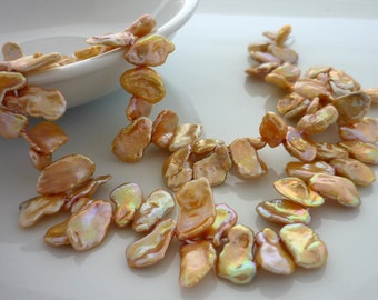 Champagne top drilled keshi petal pearls 8-11mm 1/2 strand
