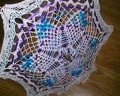 Parasol; lace doily with teal and purple accents