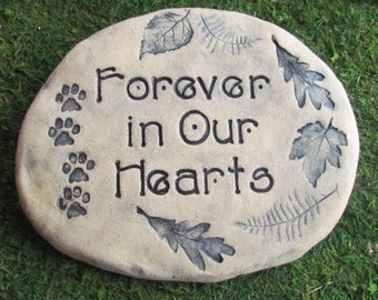 """Dog memorial stone. Dog garden memorial. Inscription """"Forever in our hearts"""" Impressions of forest leaves and paw prints. Quality materials"""