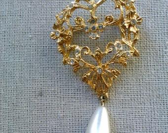 Shield style antique dangle brooch