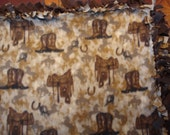Boots and Saddle tied Fleece Blanket on dark background