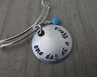 "One Day at a Time Inspirational Bracelet- ""one day at a time"" with an accent bead of your choice"