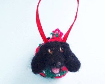 Cocker spaniel wearing a Christmas sweater ornament, ready to ship
