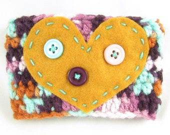 Crochet Coffee Cup Sleeve - Purple, Turquoise, White and Burnt Orange Variegated with Dark Gold Felt Heart