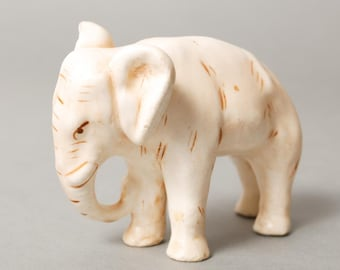 Vintage  small elephant figurine. White porcelain or clay
