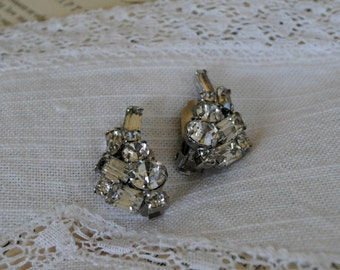 a pair of vintage jeweled clip earrings.