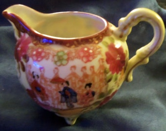 Beautifully Hand Painted Porcelain Oriental Pitcher From the Early 1900's