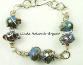 Bracelet of Blue Metallic Lampwork Beads