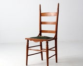 antique ladder back chair with needlepoint seat