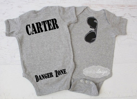 THE ORIGINAL Aviator Mirror Style Sunglasses bodysuit with Custom Name and Danger Zone on the Bum pictured in Heather Grey Pick