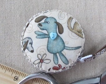 Around Town for Red Rooster Fabrics Retractable tape measure, covered with whimsical dog fabric