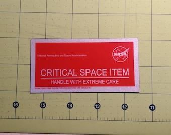 "NASA ""Critical Space Item"" reflective sticker"