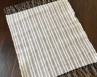 """Handwoven Rag Rug, Woven Rug, Repurposed, Recycled Fabrics. The perfect size! 24"""" wide x 28"""" long"""