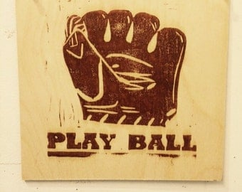 Play Ball, linocut on wood panel