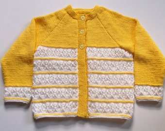 Hand knitted toddler girl's cardigan. Yellow and white 2 tone cardigan. To fit 26 inch chest.