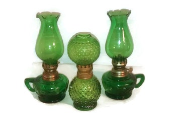 Green glass vintage oil lamps , three count ,