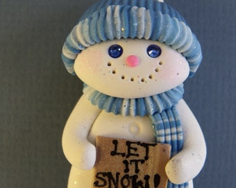 Snowman with Let it snow sign  Pin
