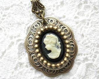 Ivory and Black Cameo Pendant in Antiqued Brass Filigree