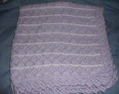 handknitted baby blanket in purple and white