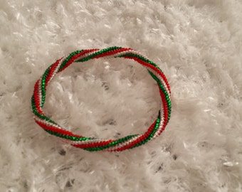 Red, white and green beaded bracelet